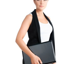 serious young woman standing with laptop. formal wear. isolated