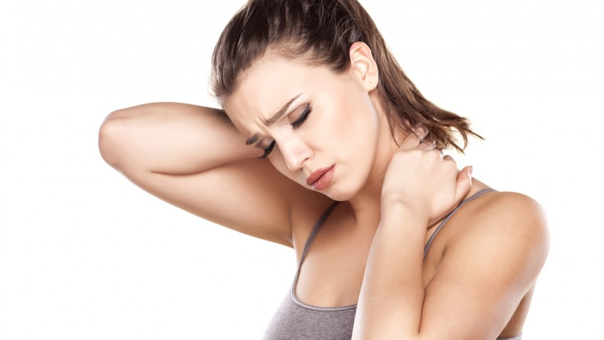 beautiful young woman has a pain in the neck