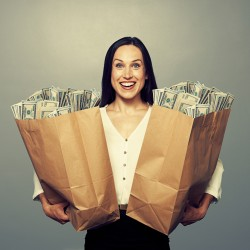 woman holding two paper bags with money