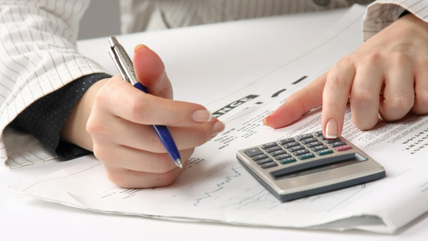 Business woman working with tax documents.