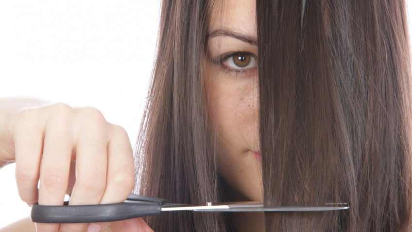 Young Woman Cutting Hair. Model Released