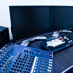 editing station with audio mixer and dual monitor