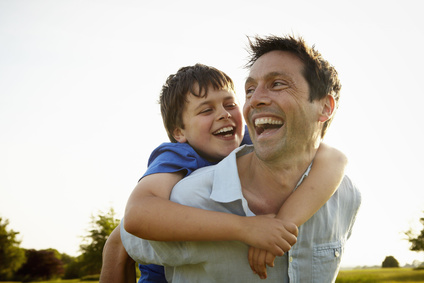 A father giving his son a piggyback.