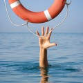 Lifebuoy for drowning man in sea or ocean water
