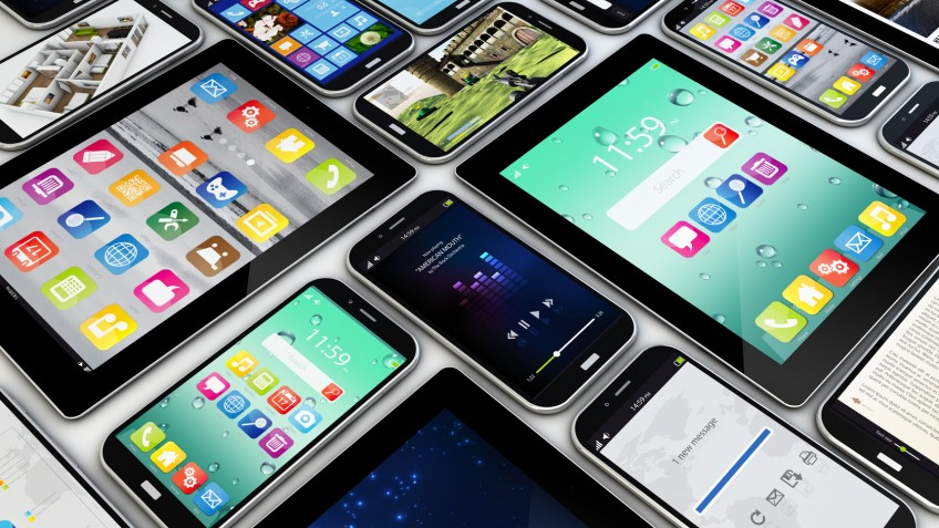 applications concept: a group of mobile devices with apps on the screens