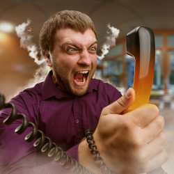 Angry bearded man screaming into the phone
