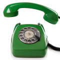 Green retro telephone on white background