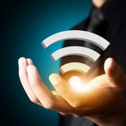 Wifi technology symbol in businessman hand