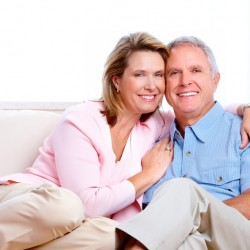 Senior couple at new home. Retirement security concept.