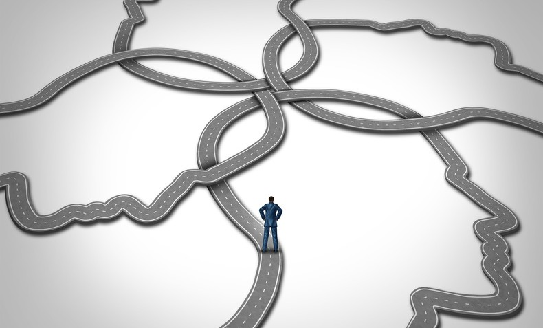 Social management and career manager business concept as a person standing on a group of connected roads that are shaped as a human face as a symbol of public relations and managing people.