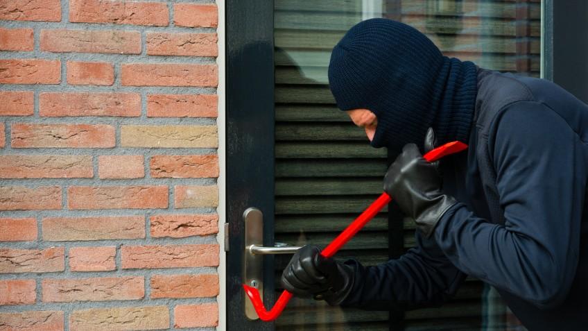 Burglar carrying the tool of choice