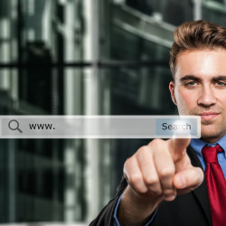 Business man clicking a search button