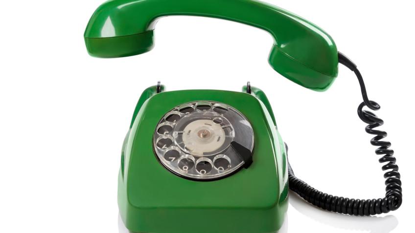 Green retro telephone on white background